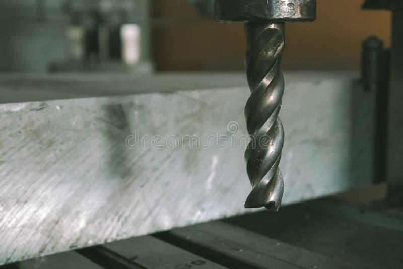 在金属材料的钻子在机器 图库摄影