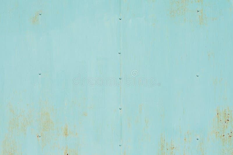 在金属片的抽象油漆纹理 橙色和绿色backgrou 免版税库存图片