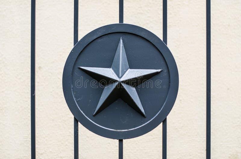 在金属的灰色金属星军队军事操刀门 库存图片