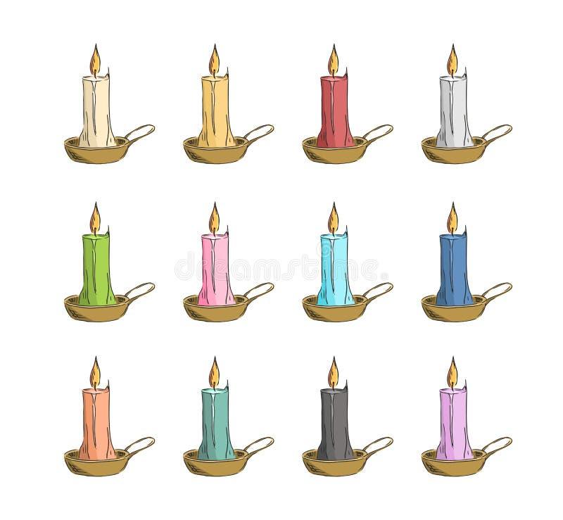 在金烛台的色的蜡烛 免版税库存照片