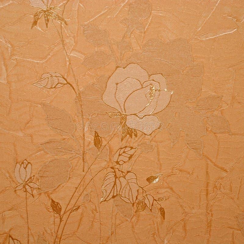 在金黄设计的减速火箭的花卉墙纸 库存照片