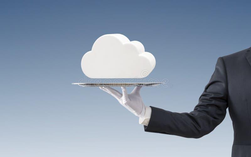 在银色盘子的商人提供的白色云彩 免版税库存图片
