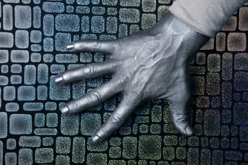 在银色钢的未来派现有量人构造了 库存照片