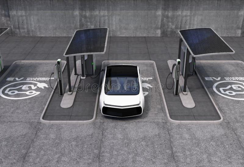 在银行营业厅的电动车充电站 免版税库存照片