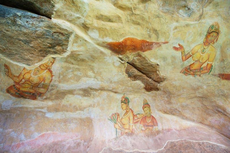 在锡吉里耶岩石的古老损坏的绘画在锡吉里耶,斯里兰卡 图库摄影