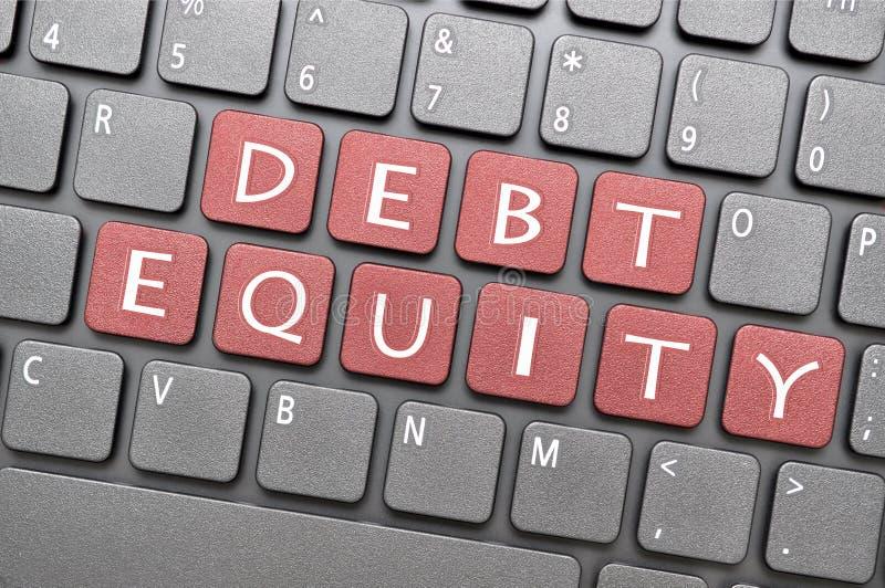 在键盘的债务产权 库存照片