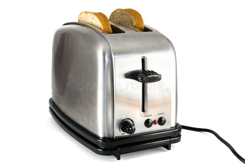 在镀铬物发光的片式多士炉二上添面包 免版税库存照片