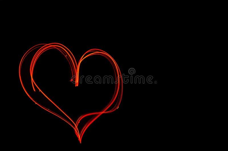 在长的曝光的火热的心脏在晚上 Unfocussed纹理 库存例证