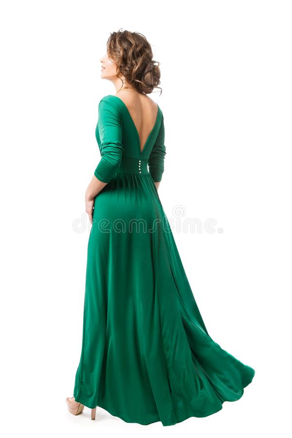 在长的礼服后面视图,在褂子背面图的妇女秀丽的时装模特儿,全长在白色 库存图片