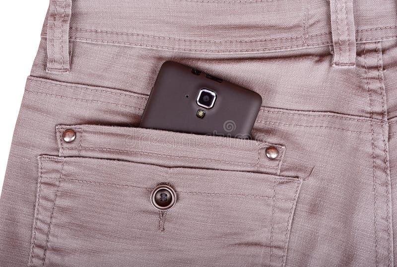 在长裤的手机支持口袋 免版税库存图片