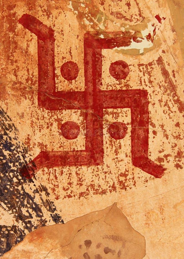 在门的一个吉利十字记号标志 免版税库存照片
