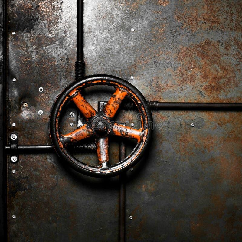 在门的橙色阀门 免版税库存图片