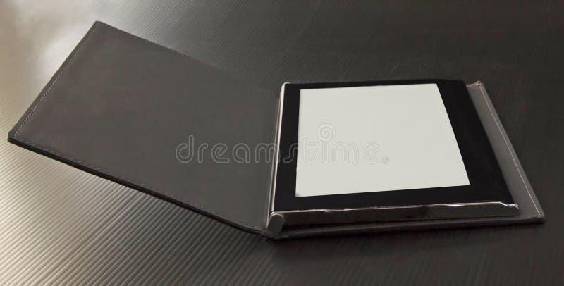 在阅读程序的背景黑色ebook 免版税库存图片