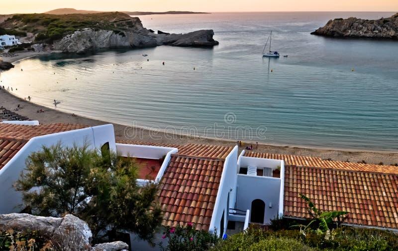 在阿雷纳尔小室卡斯特尔海湾的日落,梅诺卡岛,西班牙 图库摄影