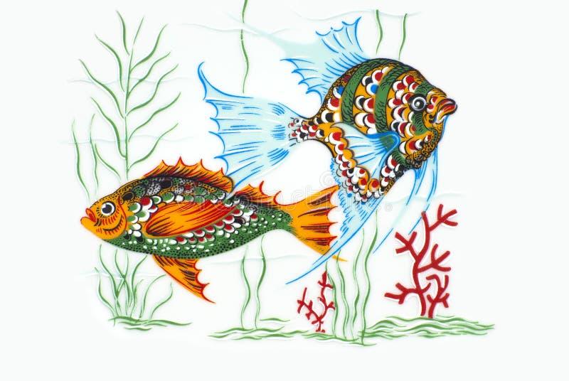 在陶瓷的五颜六色的鱼 免版税库存照片