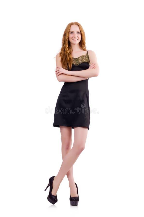 在隔绝的典雅的黑套衫连超短裙的一个女孩 库存图片