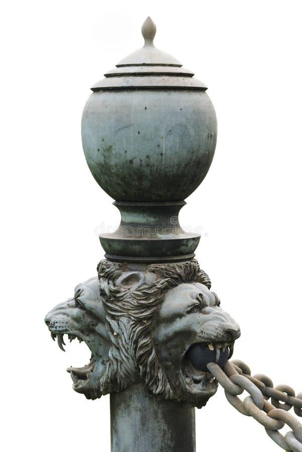 在隔绝的古铜色狮子的头 库存照片