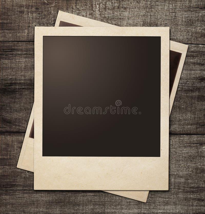 在难看的东西木背景的偏正片照片框架 库存照片