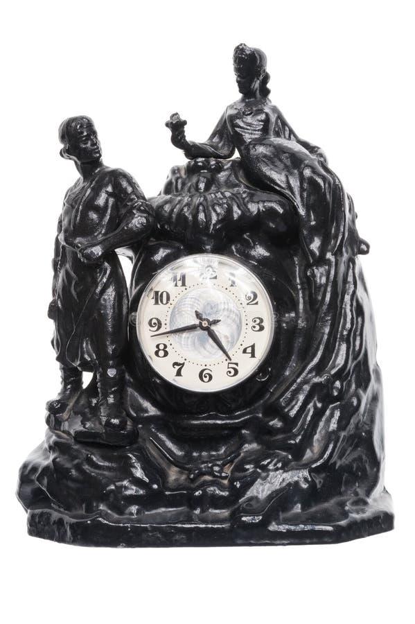 在雕塑的台式时钟 免版税库存图片