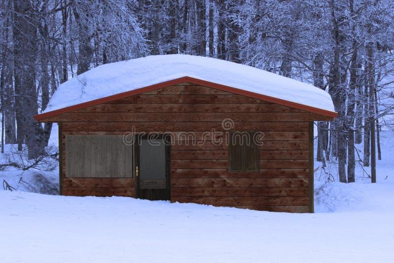 在雪的一点小屋 库存图片