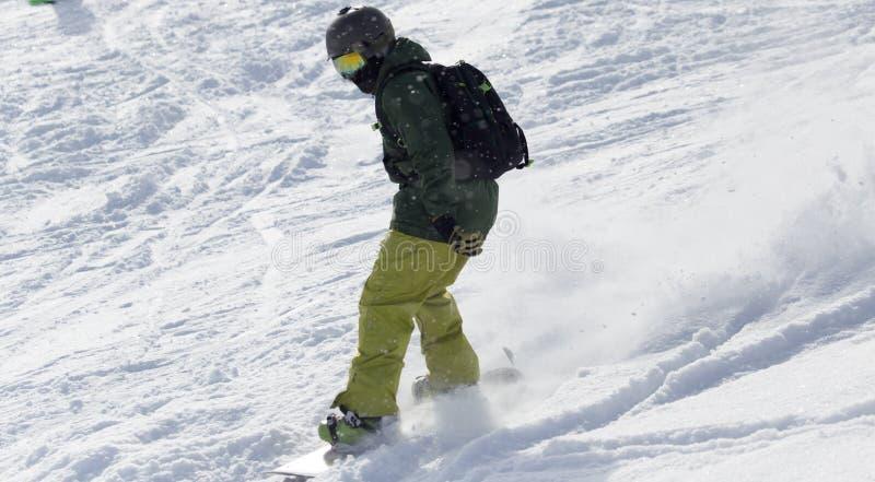 在雪的人雪板运动 免版税图库摄影