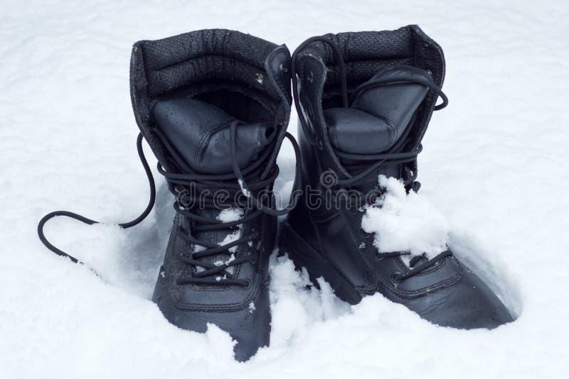 在雪的启动 免版税库存图片