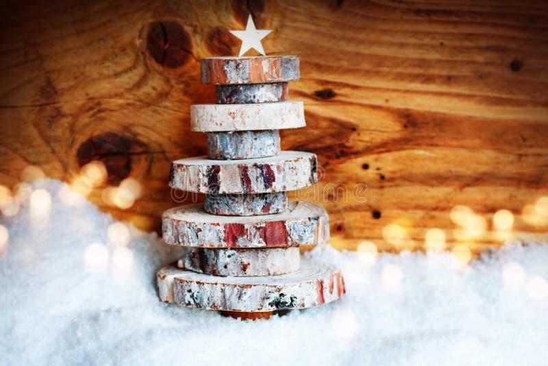 在雪的木圣诞树 免版税库存照片
