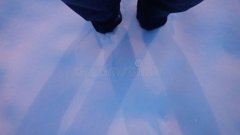 在雪的腿 免版税库存照片