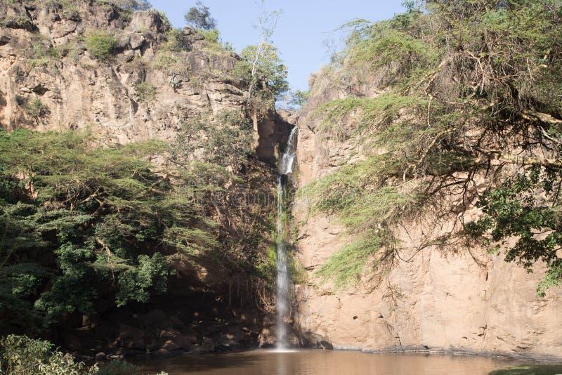在非洲半沙漠的瀑布 免版税库存照片
