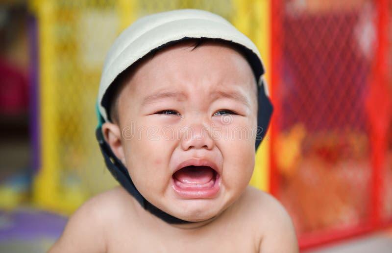 在面孔,婴孩哭泣的泪花 免版税库存照片