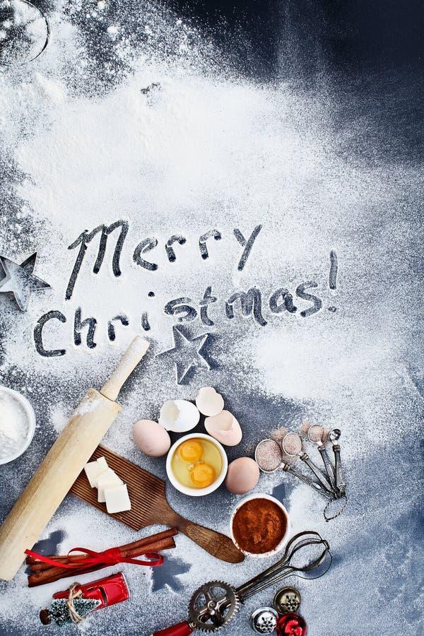 在面粉写的圣诞快乐 免版税库存照片