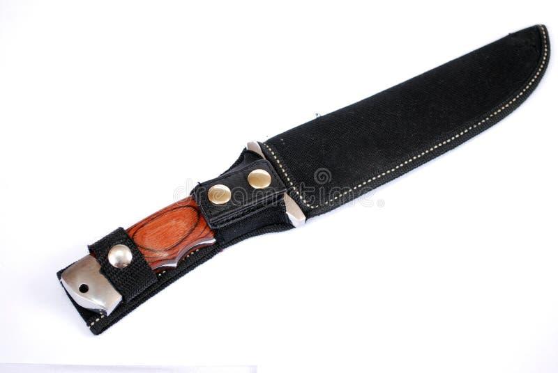 在鞘的大锋利的猎刀在白色背景 猎人的冷的武器 免版税库存照片
