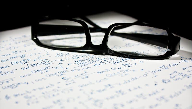 在页的玻璃算术 库存照片