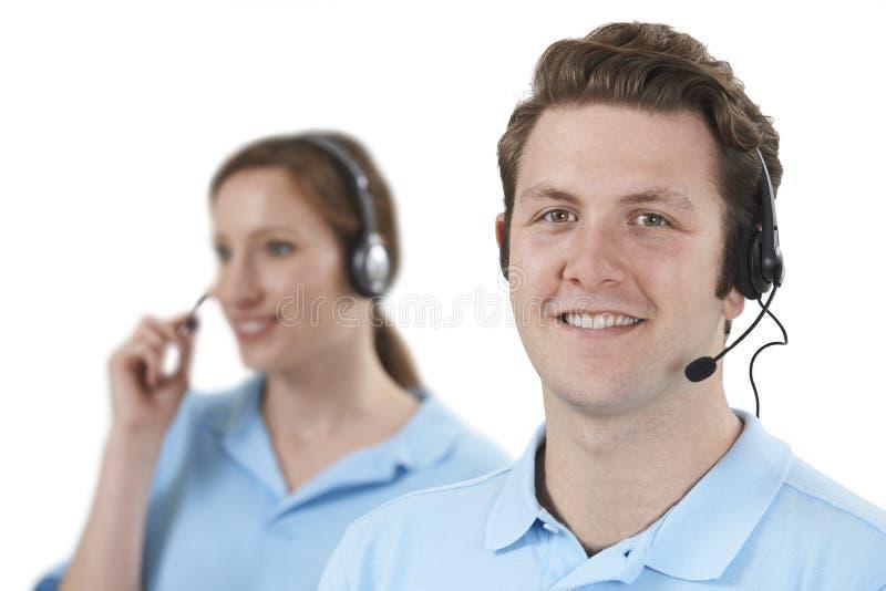 在顾客服务部的职员回答的电话 图库摄影