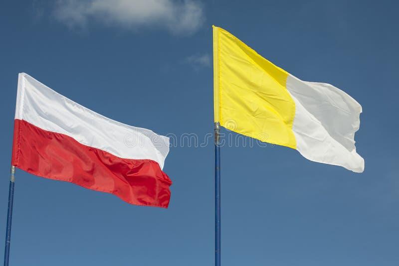 波兰人和梵蒂冈旗子 库存照片