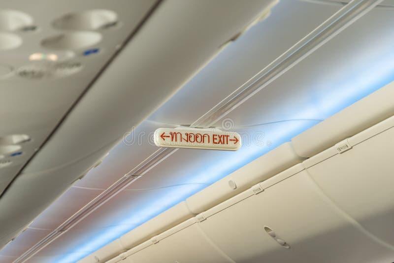 在飞机的紧急出口行 图库摄影