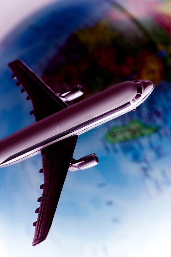 在飞行世界范围内 免版税库存照片