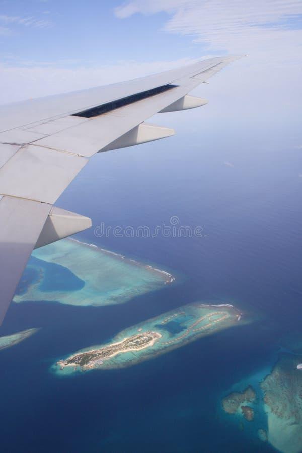 在飞行马尔代夫之上 免版税图库摄影