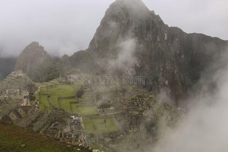 在马丘比丘的强的雾,秘鲁 图库摄影