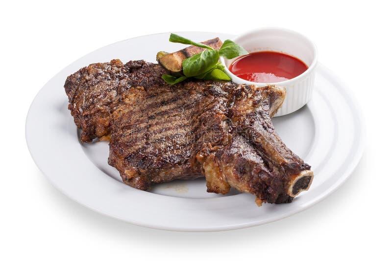 在骨头的小牛肉牛排 库存图片