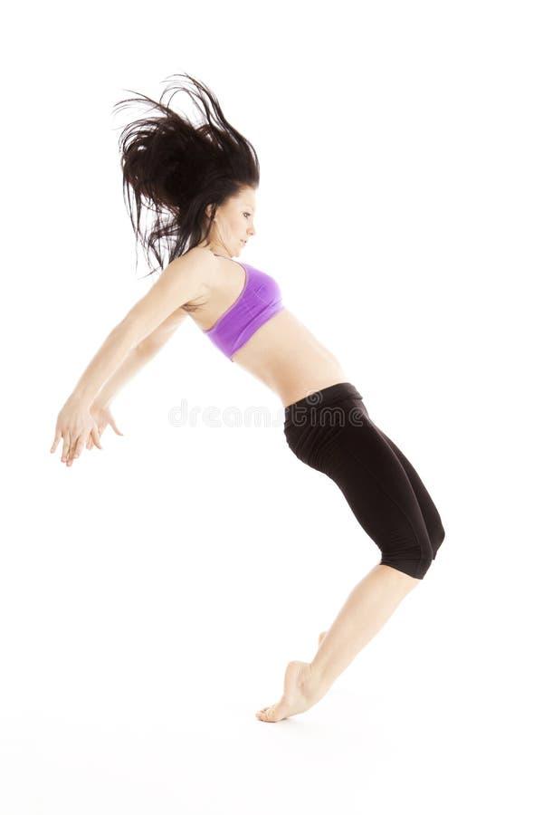 在高压的女性跳芭蕾舞者 库存照片