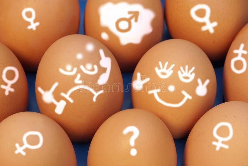 在鸡蛋的图画面孔用不同的情感,  免版税库存照片