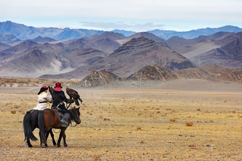 在鹫节日期间的马骑术竞争 库存图片