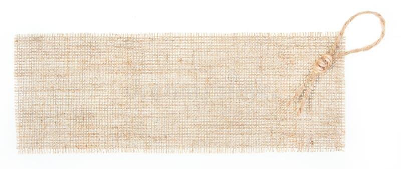 在麻袋布标签白色的装饰 免版税库存图片