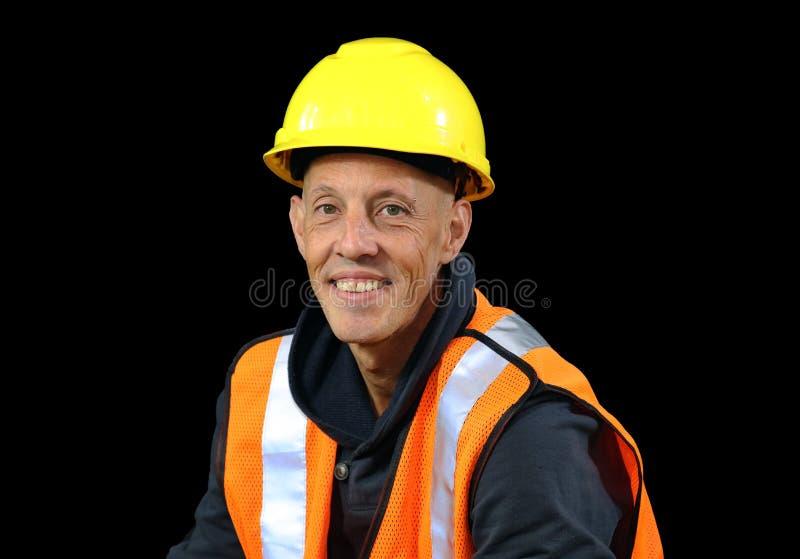 在黄色安全帽子,橙色背心,红色手套的建筑工人男性,使用Google和准备好工作 免版税库存图片