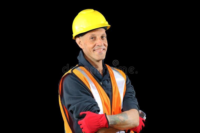 在黄色安全帽子,橙色背心,红色手套的建筑工人男性,使用Google和准备好工作 免版税库存照片