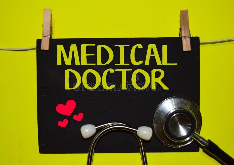 在黄色背景顶部的医生 库存图片