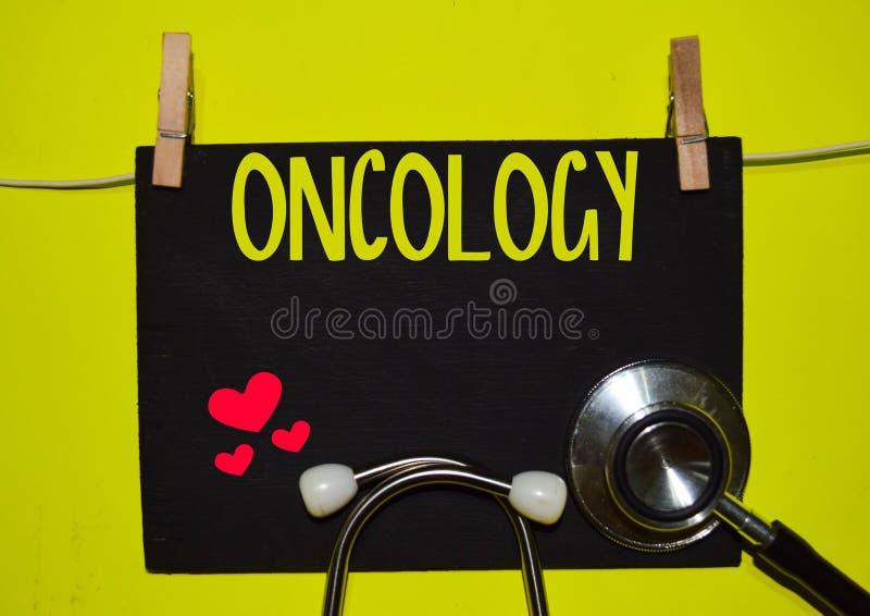 在黄色背景顶部的肿瘤学 库存图片