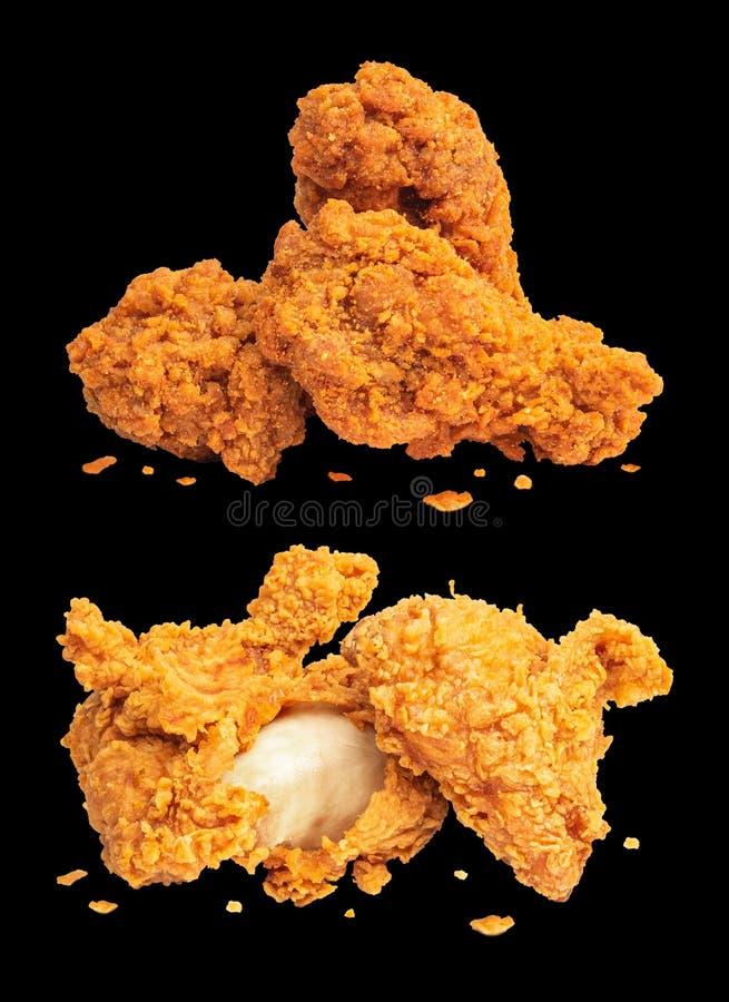 在黑暗的背景隔绝的炸鸡 油炸酥脆便当 免版税图库摄影