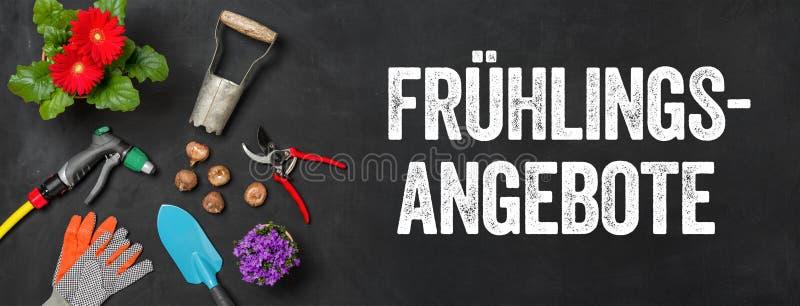 在黑暗的背景-春天提议的园艺工具- Fruehlingsangebote德语 免版税库存照片